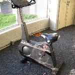 Broken exercise machine. There were 3 broken machines in the empty exercise room.