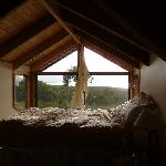 Bed in the window - and the view beyond