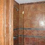 Pressure enhanced tile showers
