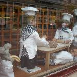  puppets in a backery`s window