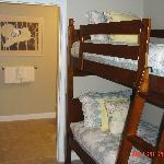 Bunk beds in area leading to guest bathroom and shower