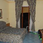  Our room, double bed and a twin bed, great door to balcony!