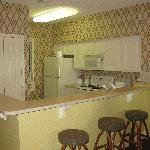Kitchen with corian counters, full size appliances, bar stools, and a first (for us) a pantry!..