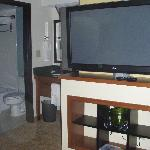 Flat-screen TV swivels to face sitting area or bed