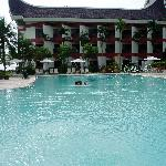 the hotel pool and hotel front