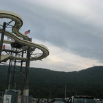 Picture of the water slide set along side a mountain.
