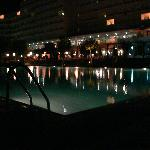 Night time by the large family pool
