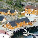 All the orange buildings and decked jetty are part of the Hostel