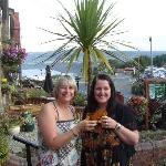 me and friend in the front garden of Devon House
