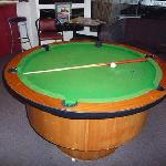 They have a round pool table!