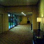 Breezeway or hallway from lobby to exercise room and elevator