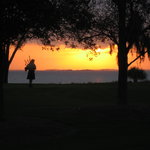 Bagpiper at sunset