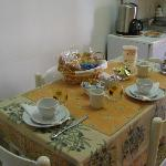 A lovely cheeful, bright kitchen where breakfast is served. The space is also avail for lunch