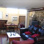Living room in Carriage House- note the really cool fireplace!
