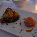 Stuffed fig with ham & cheese next to Salmon tartar