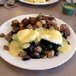 Eggs Benedict with assorted mushrooms & spinach.