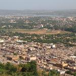 View of Bamako with covered market in foreground, hippodrome in centre and river Niger in distan