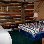 One of six cozy guest rooms