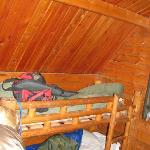 My bunk with shotgun, sleeping bag and bag.