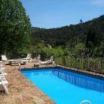 Solar heated swimming pool overlooks tranquil valley