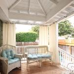 Private porch with curtains - cabana feeling - within private yard w/barbe