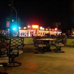 night time view of the common space corner patio, looking toward El Ranchito