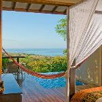 Wake up surrounded by lush tropical gardens and amazing ocean views in your private villa.