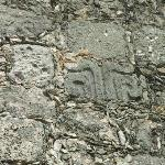 mayan stone used in church wall
