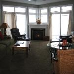 Fireplace between floor to ceiling windows