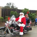  Santa arrives in style.