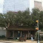 Old Cabin @ Houston Heritage Park with Houston skycrappers at background