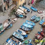 Looking down on fishing boats from veranda