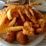 Frog legs, hush puppies, and fries