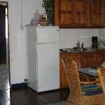 Kitchen and dining area of white apt.