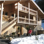 Kids playing in the snow outside chalet