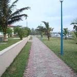 Walkway along the fenced in beach