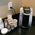 Mini brewer with complimentary coffee and hot chocolate.
