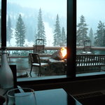 Looking out at the firepit & snowy mountains from our table.