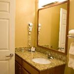 The bathroom with full shower and granite counter