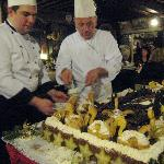 Chefs cutting cake at New Year's Eve party