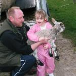 Holding new born lamb