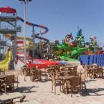 Large slide area, more chair, tables, loungers to right