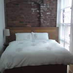 Lovely bedroom with exposed brick wall