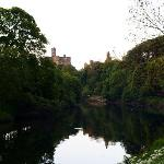 view of warkworth castle on the river walk