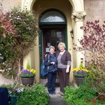 Owner LIz on right outside B&B