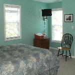  One of the smaller bedrooms, with small flat screen TV