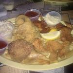  Seafood Sampler Plate ($14.00)  Shrimp,Crab,Clam,Fish,Cole Slaw, and Fries.