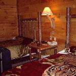 Double bed room with tiger covers