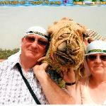 my wife and I with a camel
