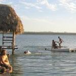 "tourists rest on El Remate's ""love beach"" on Peten Itza's lake shore"